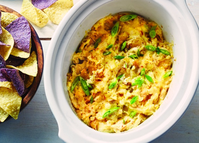 Four cheese artichoke dip made in a slow cooker or crockpot