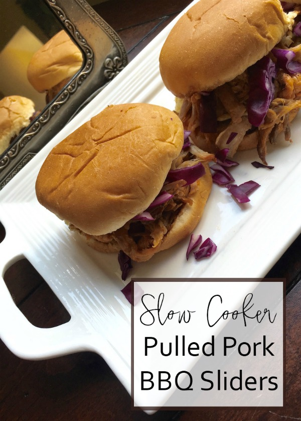 These slow cooker BBQ Pulled Pork Sliders are a perfect dish for game day, or an easy weeknight dinner. The recipe is so super simple, and you can toss everythingin your crockpot and let it cook. can easily be doubled or tripled to feed a crowd.